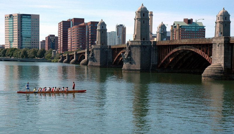 A photo of a row team canoeing down the Charles River. The Charles River (sometimes called the River Charles or simply the Charles) is an 80 mi (129 km) long river in eastern Massachusetts. From its source in Hopkinton the river flows in a northeasterly direction (after first coursing due south through Milford), traveling through 23 cities and towns before reaching the Atlantic Ocean at Boston