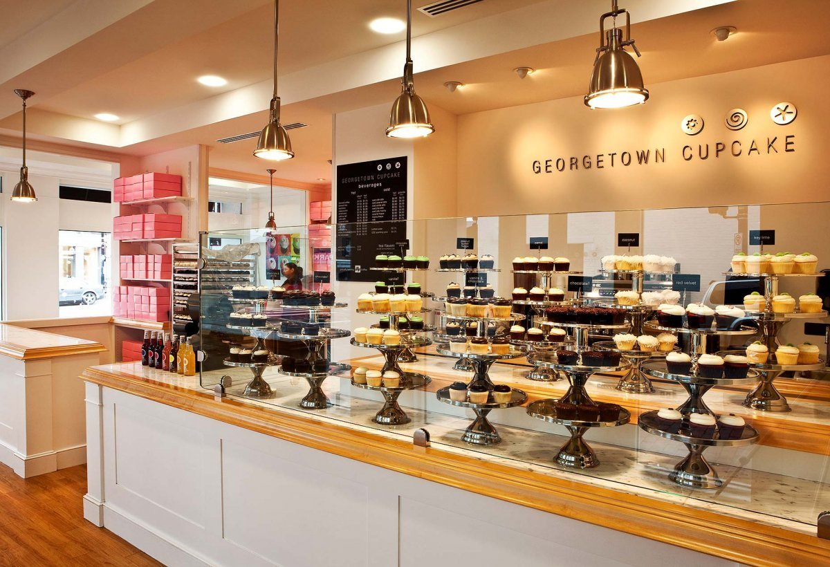 Photo of the inside of Georgetown Cupcake's shop. Georgetown Cupcake is a cupcakery based in the Georgetown neighborhood of Washington, D.C. that has now expanded to 6 other locations nationwide. Sisters Katherine Berman (née Kallinis) and Sophie LaMontagne (née Kallinis) opened the shop in February 2008.