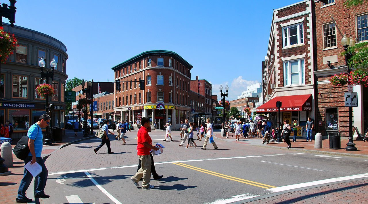 Photo of Harvard Square Neighborhood. Harvard Square is a people-watcher's paradise, as the bustle of bookish Harvard students, mohawked punks, camera-toting tourists, homeless panhandlers, buskers and harried businesspeople creates a diverse and colorful street scene. It is of course intimately tied to the university of the same name, which boasts a panoply of sights, monuments and eye-popping architecture within its modestly sized campus.