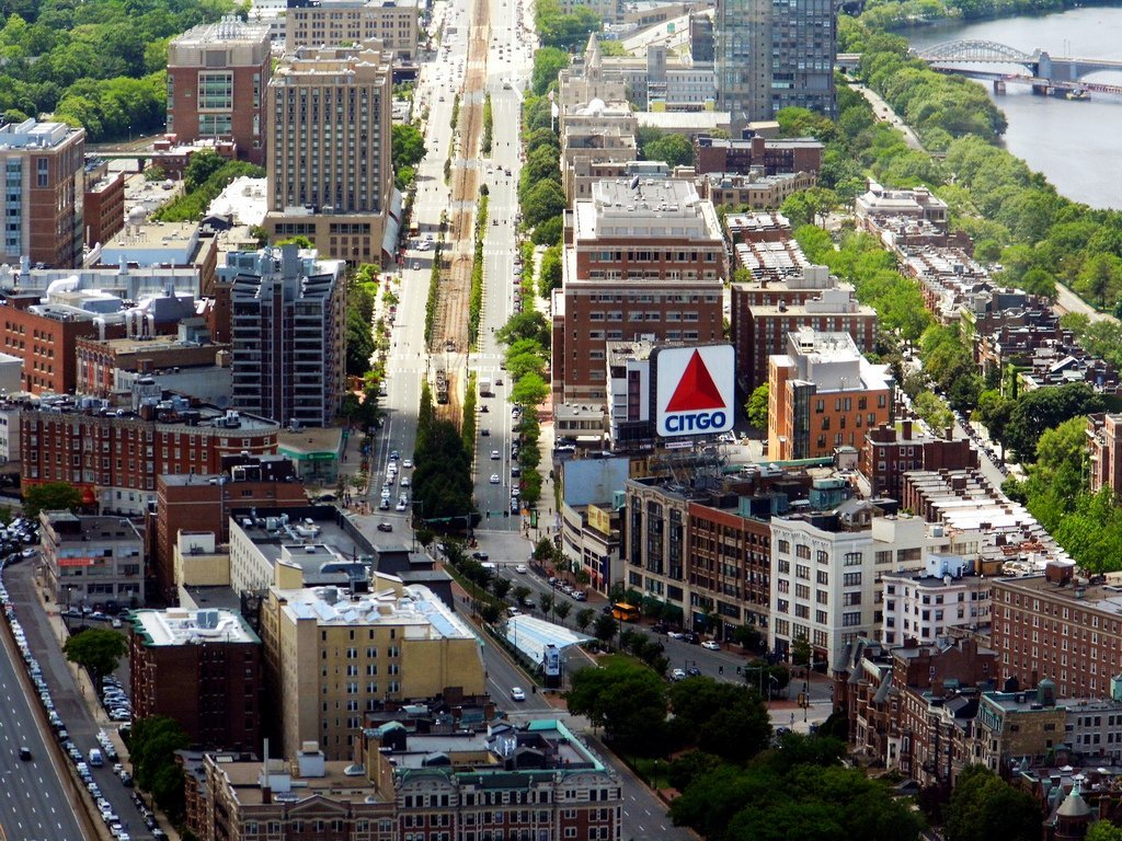 A photo of Kenmore Square & the Citgo sign from the Prudential Tower. Kenmore Square is a square in Boston, Massachusetts, United States, consisting of the intersection of several main avenues (including Beacon Street and Commonwealth Avenue) as well as several other cross streets, and Kenmore Station, an MBTA subway stop. Kenmore Square is close to or abuts Boston University and Fenway Park, and it features Lansdowne Street, a center of Boston nightlife, and the iconic Citgo sign. It is also the eastern terminus of U.S. Route 20, the longest U.S. Highway.