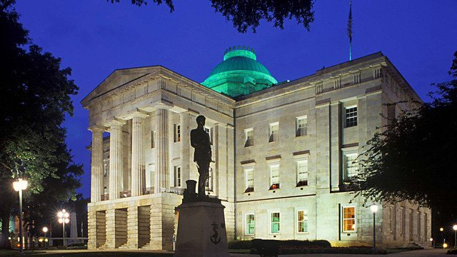 Nighttime photo of the North Carolina State Capitol building in Raleigh, NC. The North Carolina State Capitol is the former seat of the legislature of the U.S. state of North Carolina. Currently housing the offices of the Governor of North Carolina, it is located in the state capital of Raleigh on Union Square at One East Edenton Street. The cornerstone of the Greek Revival building was laid with Masonic honors by the Grand Master of North Carolina Masons Simmons Jones Baker on July 4, 1833