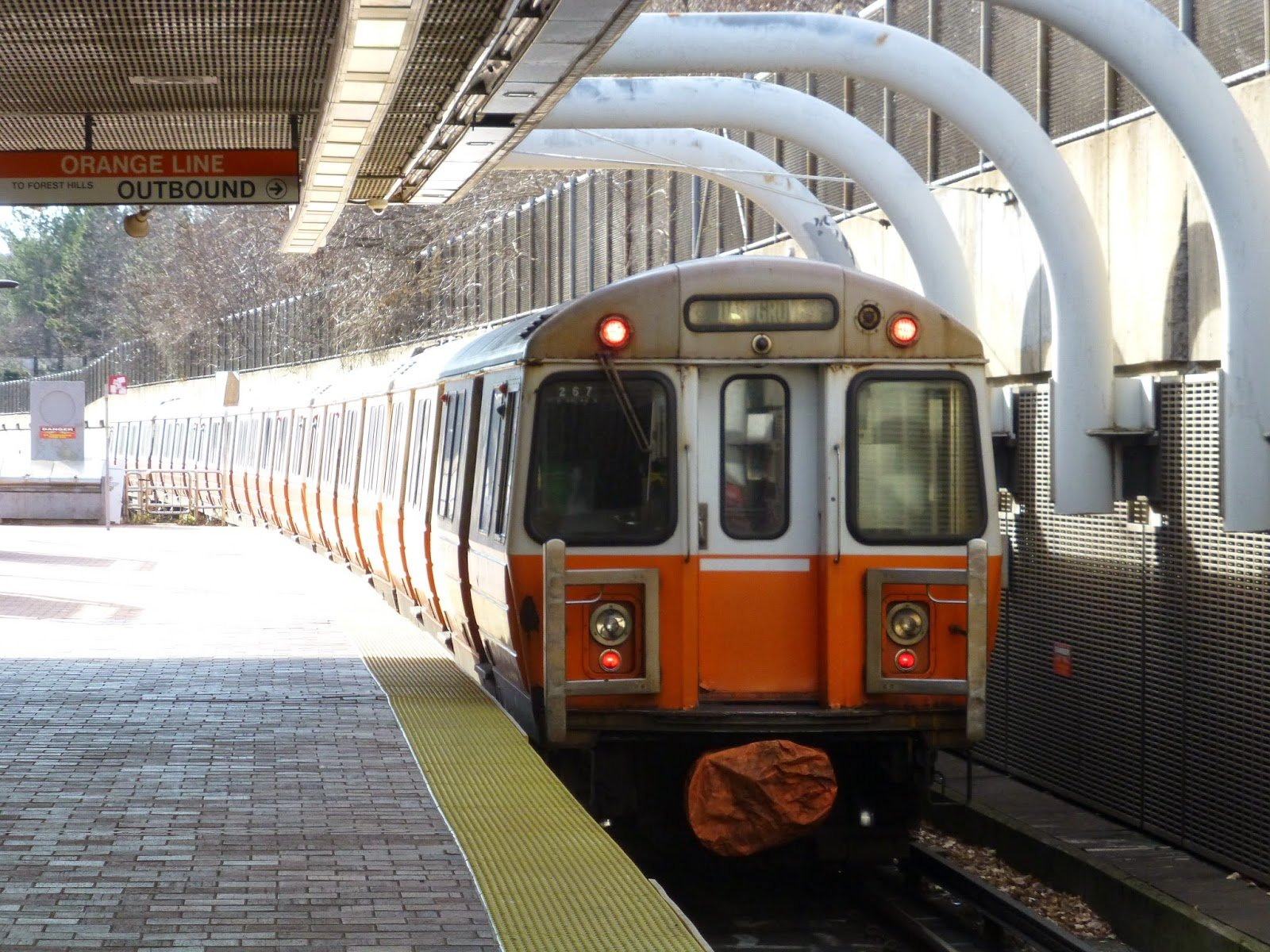 A photo of a train leaving the Roxbury Crossing Orange Line Station. Roxbury Crossing is a rapid transit station on the MBTA Orange Line, located on Tremont Street in the Mission Hill neighborhood of Boston. The current station opened in 1987 as part of the renovation and relocation of the southern Orange Line. Like all stations on the Orange Line, Roxbury Crossing is wheelchair accessible.