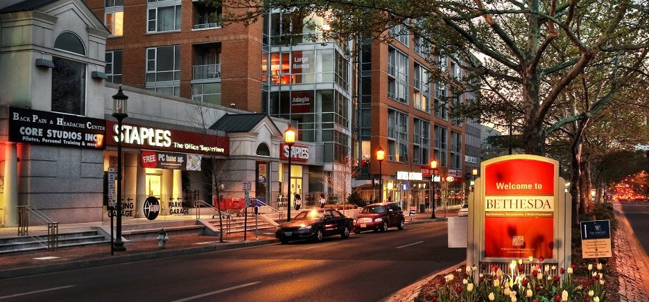 A nighttime shot of downtown Bethesda Maryland; Downtown Bethesda is home to a wealth of art galleries, more than 200 restaurants, two live theatres, several music and dance studios, and numerous designer boutiques and local shops. The major shopping and entertainment center Bethesda Row is also located downtown and is home to national designer stores, dozens of smaller boutiques and restaurants, and a movie theatre. Regardless of your taste for entertainment, you're sure to find something you love in Bethesda's vibrant downtown.