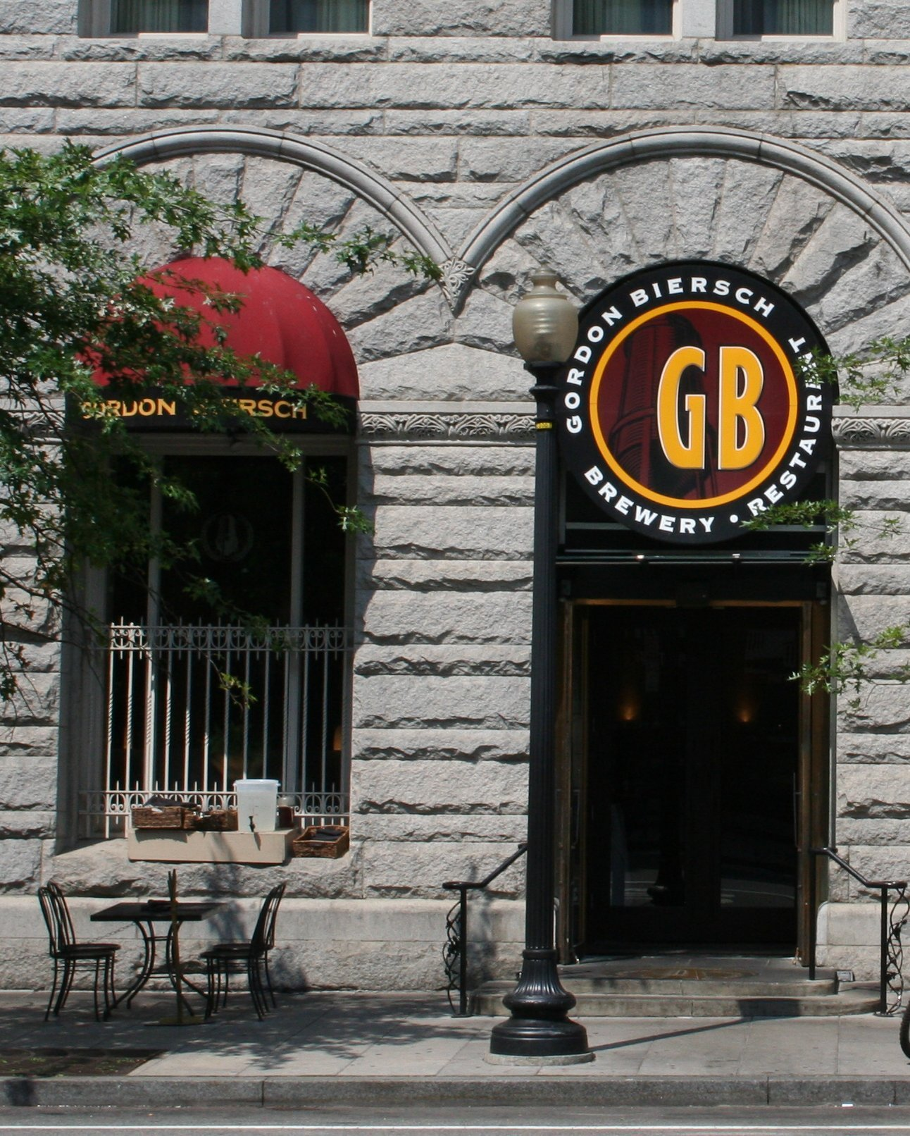 An exterior photo of Gordon Biersch; Conveniently located in the heart of Washington, DC on F Street in the old Riggs Bank Building, this architectural beauty displays the traditional elegance of the Capitol. The restaurant can accommodate 450 guests with additional patio seating available. Private banquet facilities are also available for 50-60 guests in the upstairs dining room, with a smaller private room on the main floor accommodating 30-35 persons. Full-restaurant banquets are also available seating up to 400 persons.