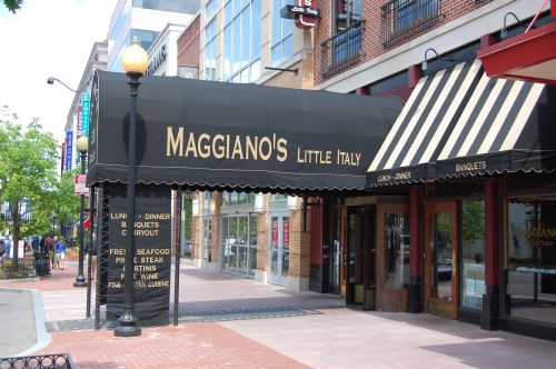 Exterior photo of Maggiano's Little Italy restaurant located in the Friendship Heights neighborhood of Washington D.C. The restaurant was successful from the very beginning, with eager diners sometimes waiting hours for an opportunity to dine family-style. The portions of Italian–American cuisine were large, reminiscent of a Sunday night visit to their grandmother's house, or as they say in Italy, nonna's casa! The recipes were simple, authentic classics, many of them coaxed out of Italian grandmothers, mothers, and aunts whose ideas of a recipe were a pinch of this and a sprinkle of that. With some trial and error, the chefs celebrated the birth of many of Maggiano's signature dishes.  With a successful opening at the Clark and Grand location, a second restaurant was opened in Oak Brook, Illinois and two years later in Skokie, Illinois. The decision to open a restaurant outside of Illinois was made, and in 1994 Maggiano's Little Italy opened in McLean, Virginia at Tyson's Corner Galleria II. As Tyson's Corner took off, it became obvious that Maggiano's had great potential to succeed nationally. With that in mind, Brinker International purchased Maggiano's Little Italy from Rich Melman of Lettuce Entertain you in 1995. Since then, Brinker has grown Maggiano's from four locations in Illinois to numerous locations across the country.