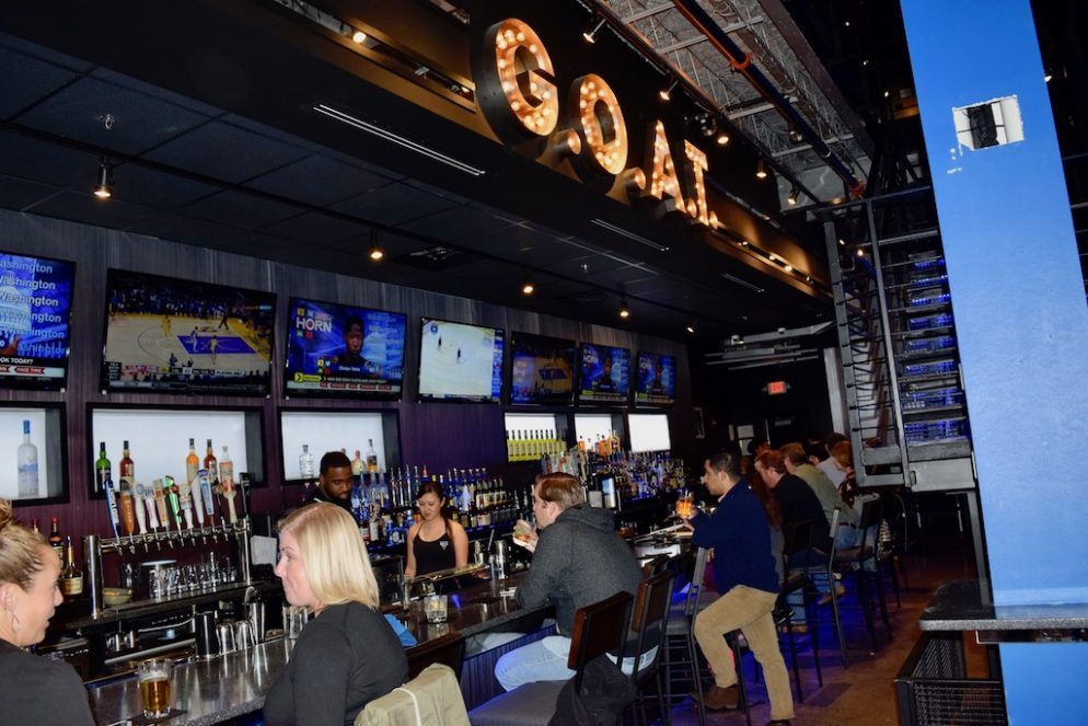 A photo of patrons sitting at the G.O.A.T Bar located in the Clarendon Neighborhood of Virginia