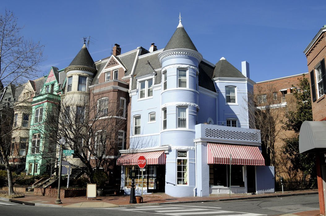 A photo of a beautiful lavendar corner home / storefront in the wonderful DC neighborhood of Georgetown