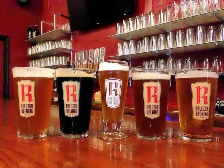 A photo of 5 delicious pints of frosty beer from Raleigh Brewing Company located in Raleigh North Carolina; Since 2013, Raleigh Brewing has become Wake County's third largest production brewery, averaging +4,500 bbl of beer per year. Atlantic Brew Supply has become the largest brick and mortar homebrew supply shop on the East Coast and ABS Commercial has expanded its tanks into 34 states and four countries.