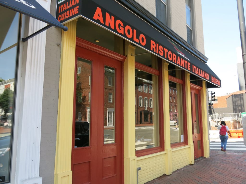 An exterior photo of Angolo's Italian Restaurant in Georgetown. Angolo's is a relaxed spot where you can come for lunch and dinner with a menu celebrating the warm spirit of Italian cuisine, while honoring the purest seasonal ingredients. Take a seat on the patio and savor a chilled glass of wine with antipasti and refreshing salad.