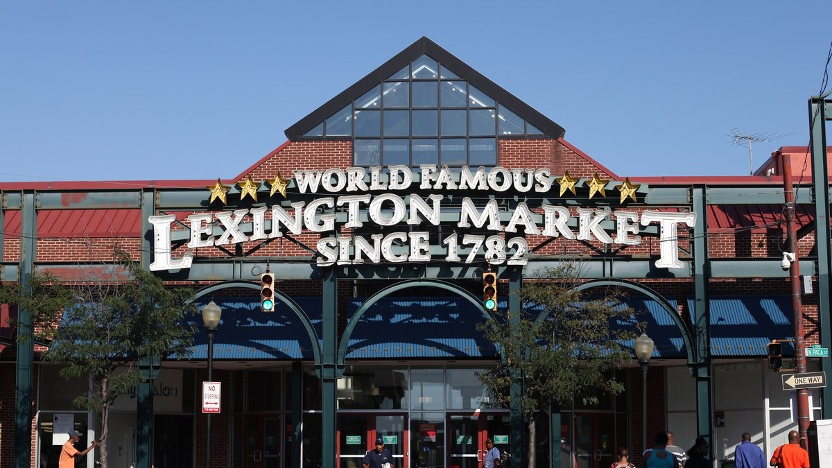 An exterior photo of the entrance to Lexington Market. Lexington Market is a historic market in downtown Baltimore, Maryland, United States. The main market is housed in two large buildings on the north corners of the intersection of Paca and Lexington Streets. In the broader sense, Lexington Market encompasses both the main market and all of the shops on Lexington Street from Greene Street to Liberty Street. The main market buildings are host to small eateries and stands selling fish, produce, meat, baked goods, and candy.