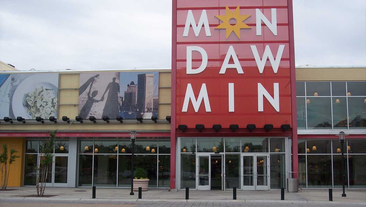 An exterior photo of the entrance to the Mondawmin Mall,  a three-level shopping mall in West Baltimore, Maryland, United States. The mall was a development of the Mondawmin Corporation, a firm set up in 1952 by James Rouse and Hunter Moss under the Moss-Rouse Company.