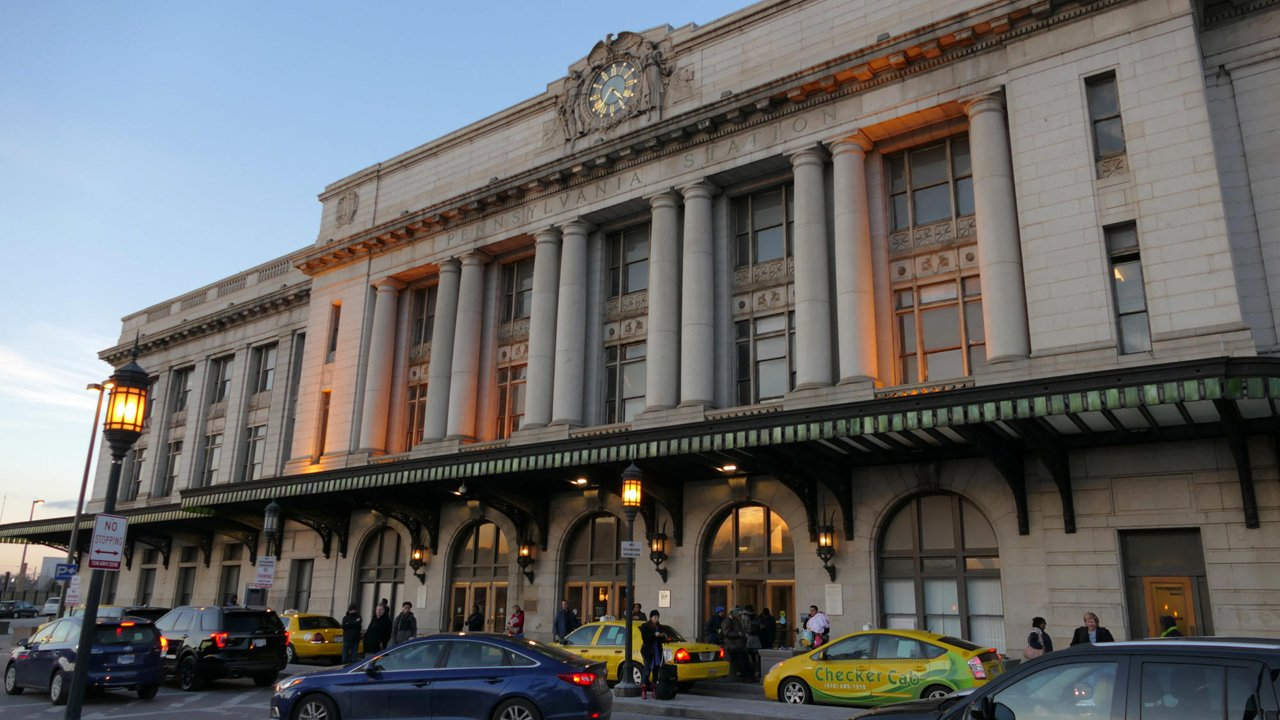 Outside Photo of Baltimore's Penn Station. Baltimore Pennsylvania Station (generally referred to as Penn Station) is the main transportation hub in Baltimore, Maryland. Designed by New York architect Kenneth MacKenzie Murchison (1872–1938), it was constructed in 1911 in the Beaux-Arts style of architecture for the Pennsylvania Railroad. It is located at 1515 N. Charles Street, about a mile and a half north of downtown and the Inner Harbor, between the Mount Vernon neighborhood to the south, and Station North to the north. Originally called Union Station because it served the Pennsylvania Railroad and Western Maryland Railway, it was renamed to match other Pennsylvania Stations in 1928.